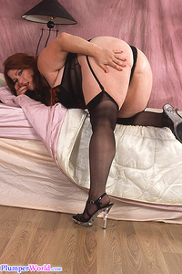 Fatty takes nylons and undies off and rubs pussy
